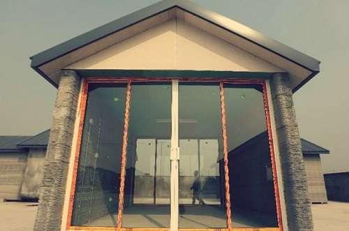 Maison imprimante 3D avec baie vitrée